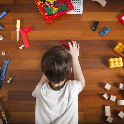 Kid with toys on Vinyl flooring | Chillicothe Carpet