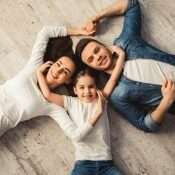 Family laying on floor | Chillicothe Carpet